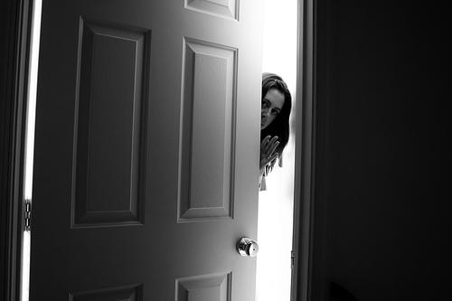 woman-opening-door