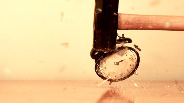 107770600-smashing-down-ringing-broken-pieces-alarm-clock