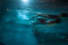 People in the pool at night, Kauai