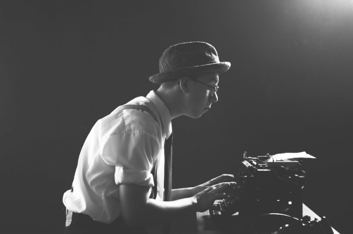 vintage-writer-at-old-typewriter